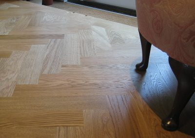 Oak herringbone parquet blocks with a light stain and oiled finish fitted in a hallway in Nottinghamshire