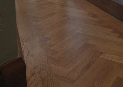 350mm long x 70mm wide oak herringbone parquet blocks with a traditional border in a long corridor near Papplewick Nottinghamshire