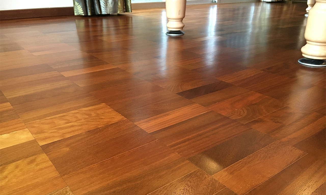 Iroko parquet block wood flooring after being sanded and restored with a satin Osmo Polyx - Oil Original