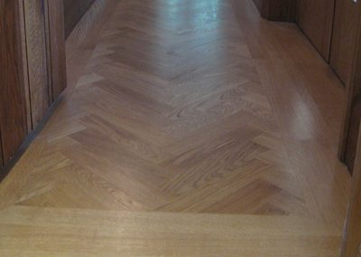 Oak herringbone parquet and border in a corridor