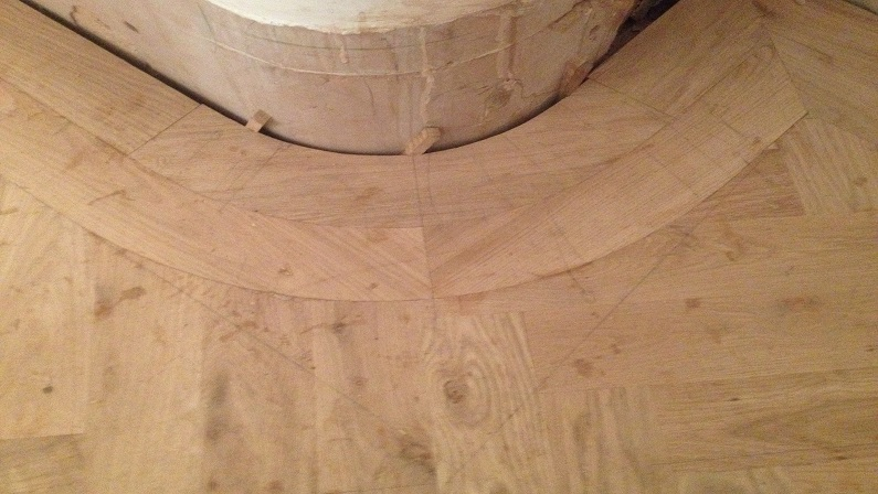 solid oak curved border to oak herringbone parquet floor under construction