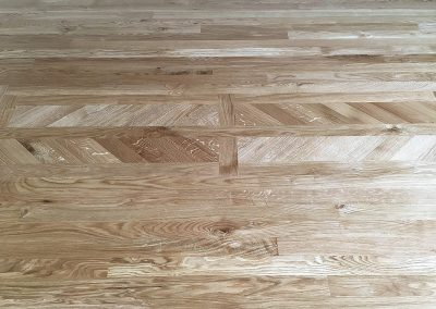 40mm wide solid Oak parquet strip flooring and elaborate oak parquet pattern in the middle of the floor in Beeston Nottingham
