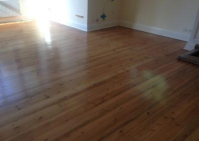 Old pine floorboards stained and lacquered