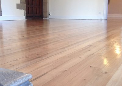 Sanded and restored old pine floorboards finished with stain and lacquer in Southwell Nottinghamshire