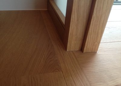 two engineered oak floors joining in a doorway without a threshold near Southwell Nottingham
