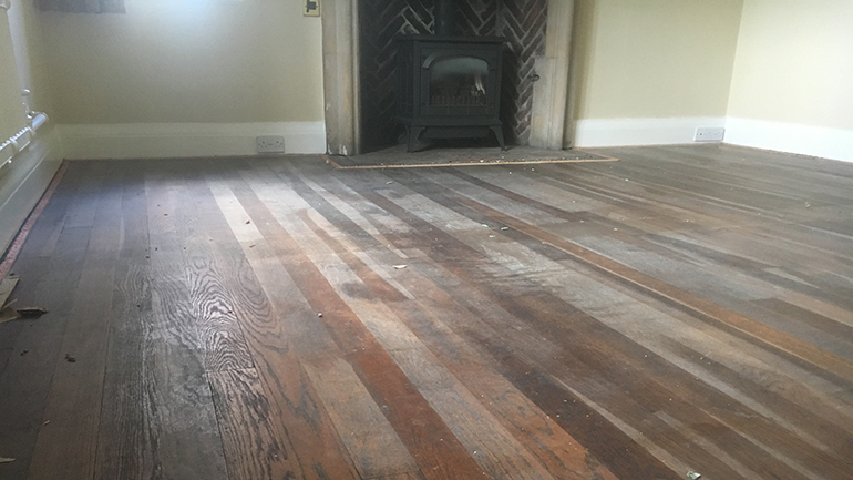 1930's oak parquet strip wood floor before restoring with a traditional wax polish
