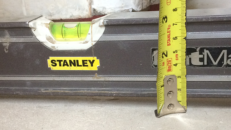 Checking the level and flatness of a subfloor before installing wood flooring, Needs to be + - 3mm over a 2M straight edge