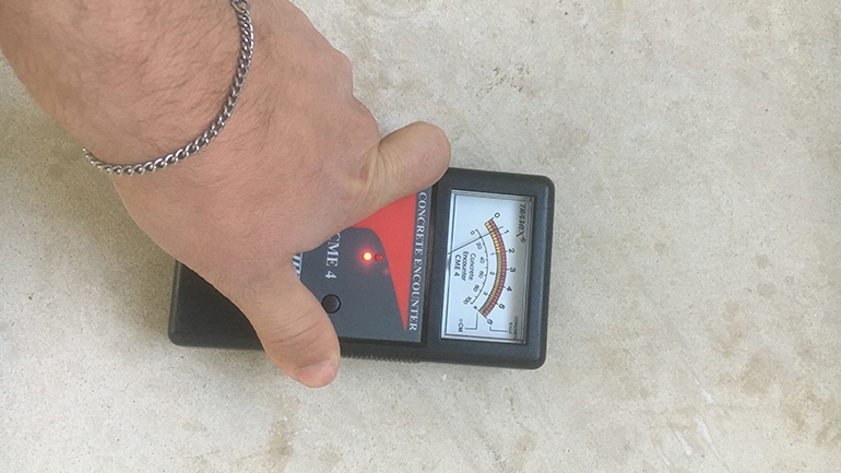 Tramex Concrete Encounter checking the moisture content of a screed before installing a hardwood floor