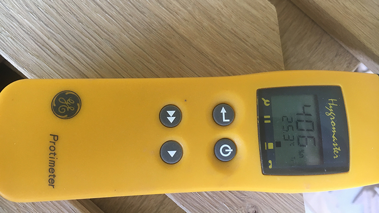 Checking the site conditions, temperature and relative humidity using a Protimeter Hygromaster before installing a hardwood floor
