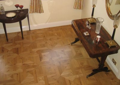 Solid oak hardwood flooring panels in a hall and kitchen in Halam Nottinghamshire