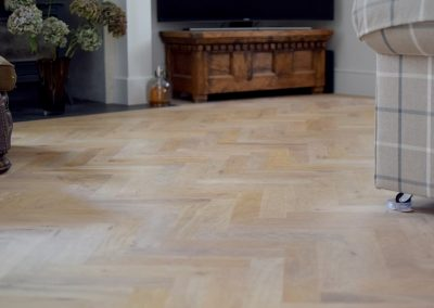 Solid oak parquet flooring fitted in a herringbone pattern with a border, finished with Blanchon Bare Environment Oil in Southwell Nottingham