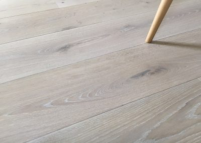 Engineered wood flooring - 180mm wide engineered oak planks with bevelled edges. Finished with a white oil.