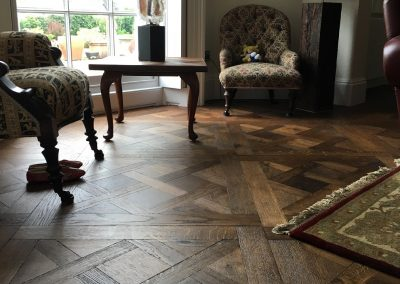 Versailles Antique HW1391 - Engineered Oak; Versailles pattern; fine aged; oiled finish, worn edge. Supplied and fitted in a sitting room, dining room, study and hallway.