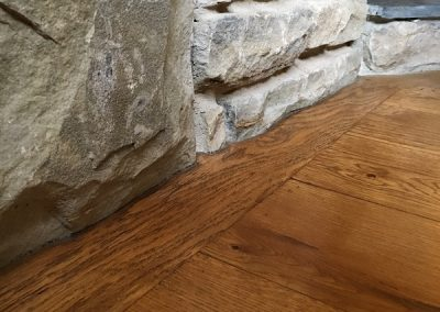 Oak flooring with a medium oak finish scribed to stone fireplace in Oxton Nottingham